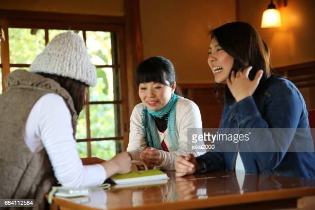 Young woman enjoying talk in cafe