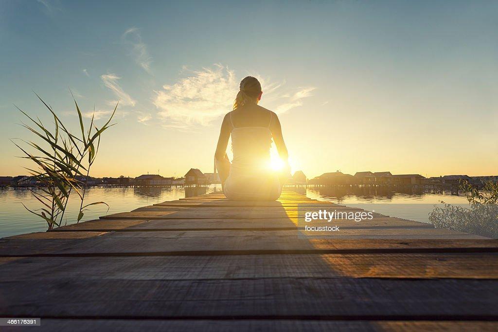 Young woman enjoying the sunset
