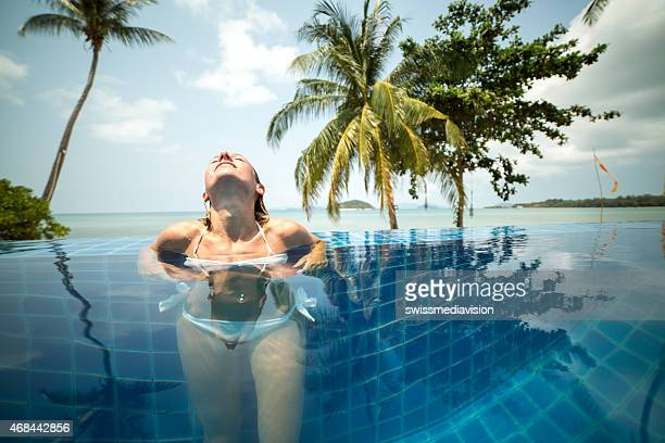 Young woman enjoying tropical vacation