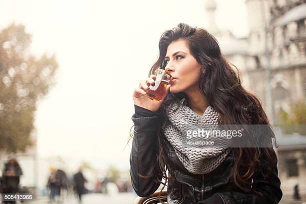 Young Woman Enjoying Turkish Tea Outdoors