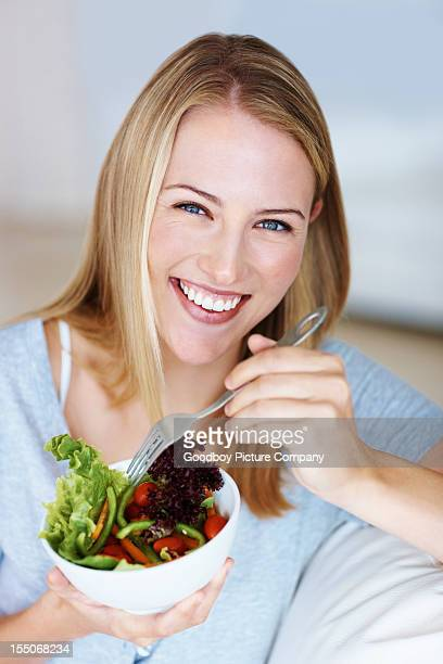 Young woman enjoying vegetable salad
