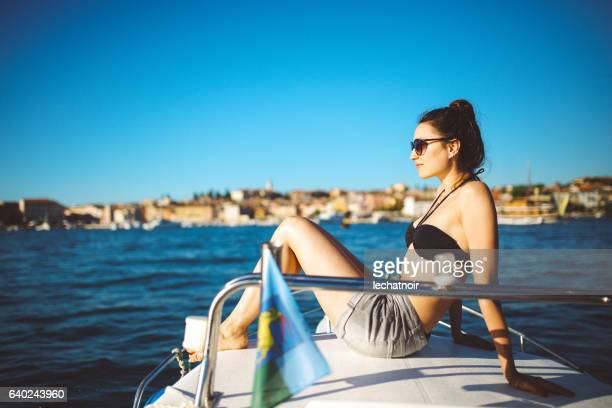 Young woman enjoys boat ride on the seaside