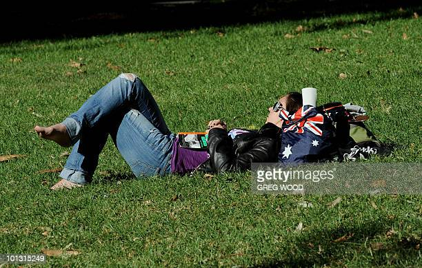 A young woman enjoys some Winter sunshine in a Sydney park on May 13 2010 Despite a current cold spell in Sydney a warmer than normal winter is on...