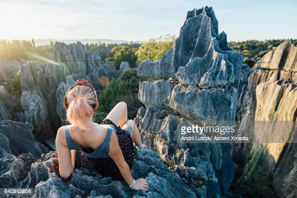Young woman enjoys view over Stone Forest, Shilin