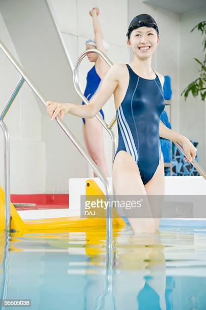Young Woman Enters Swimming Pool
