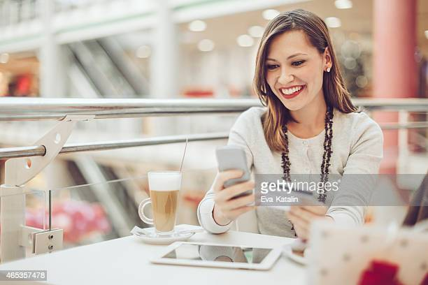 Young woman e-shopping on her mobile