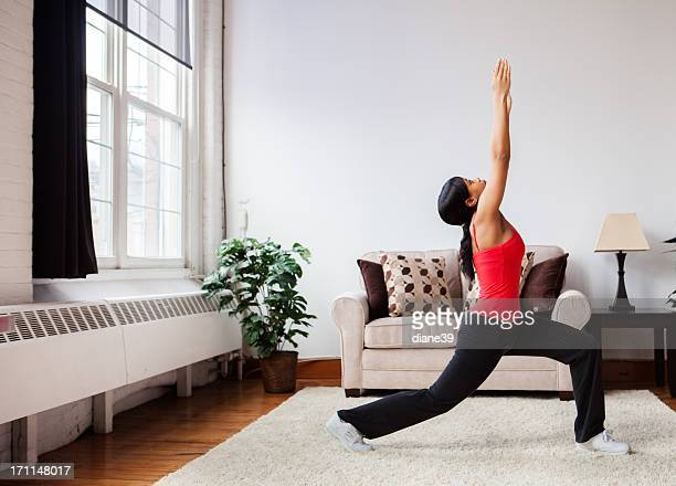 Young woman exercising in a living room