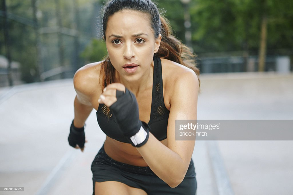 Young woman exercising in park running