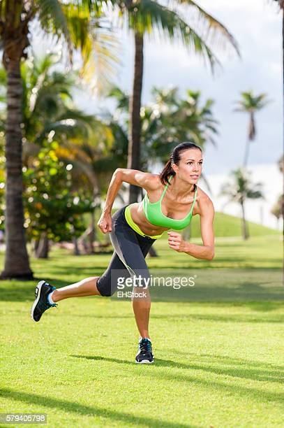 Young woman exercising in tropical park