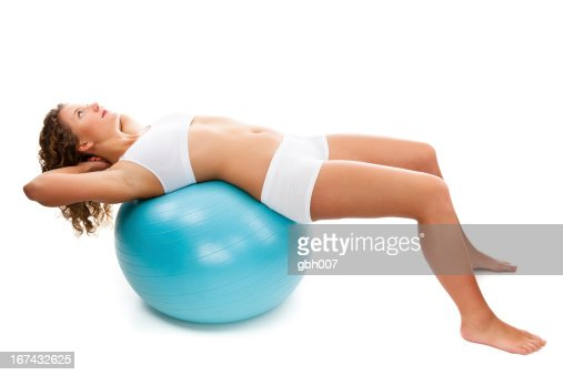 Young woman exercising isolated on white background : Stock Photo