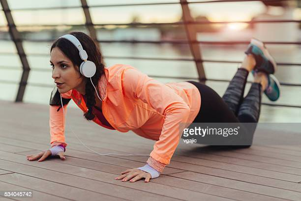Young Woman Exercising Near River.