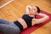 Young woman exercising on floor, Determination today  success to