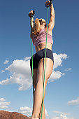 Young woman exercising outdoors, low angle view