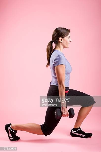 Young Woman Exercising-Lunges with Weights