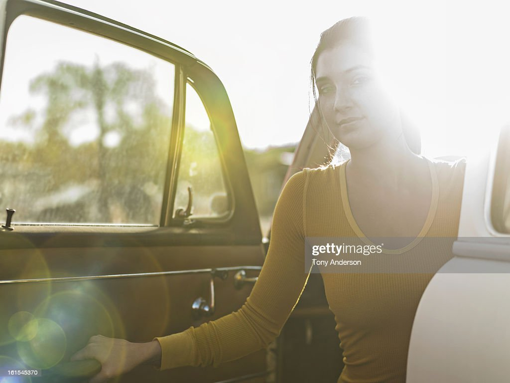 Young woman exiting car