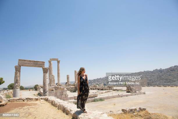 Young woman explores desert ruins and cityscape
