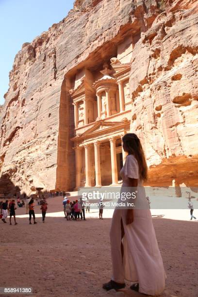 Young woman explores desert ruins from entryway