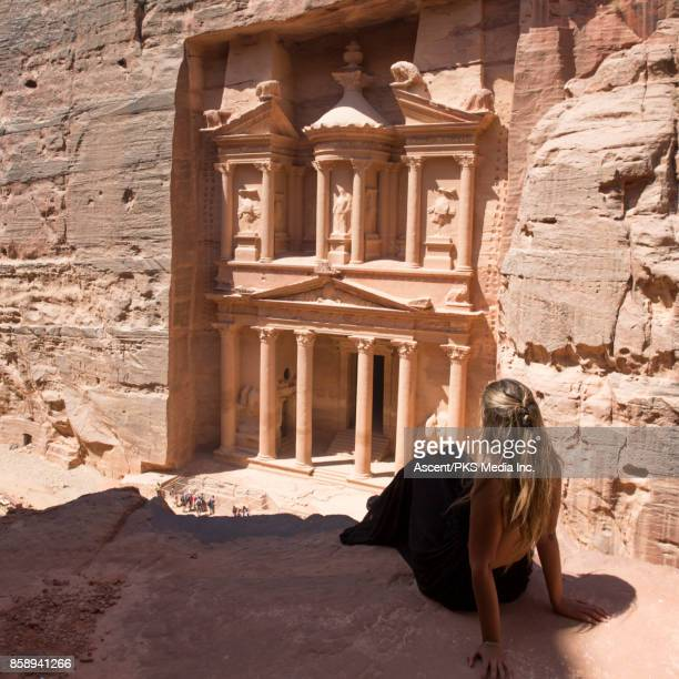 Young woman explores desert ruins from raised viewpoint