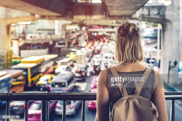 Young woman exploring streets of Bangkok