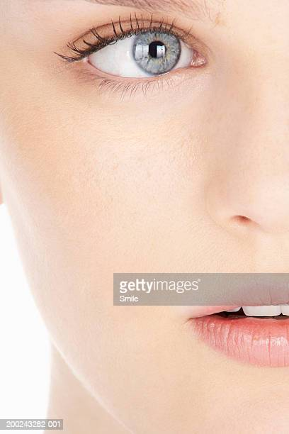Young woman, eye and mouth, close-up