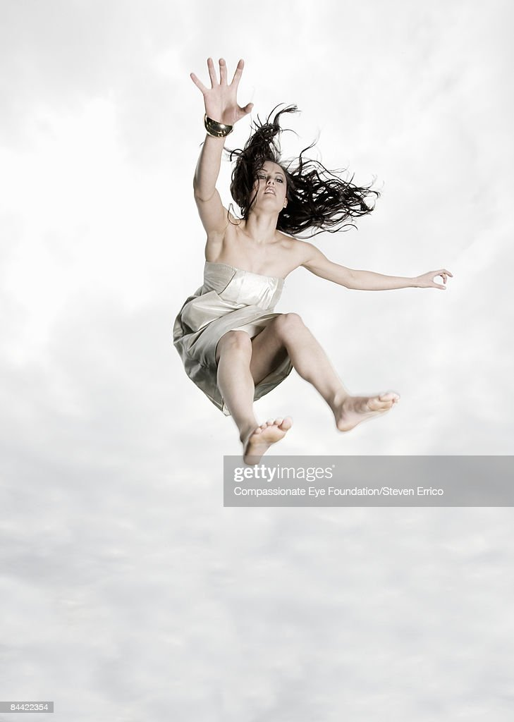 Young woman falling through the air : Stock Photo