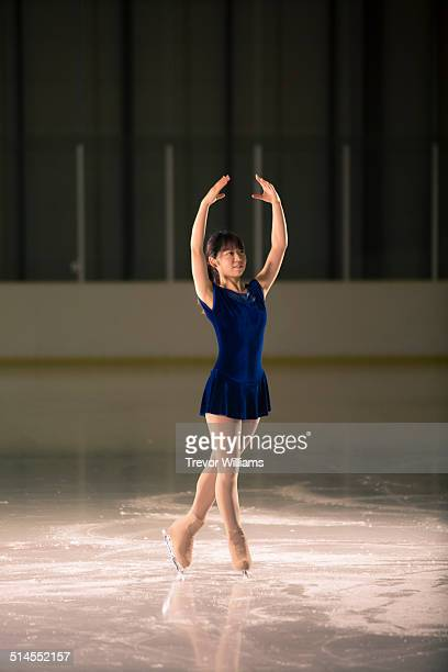 A young woman figure skating
