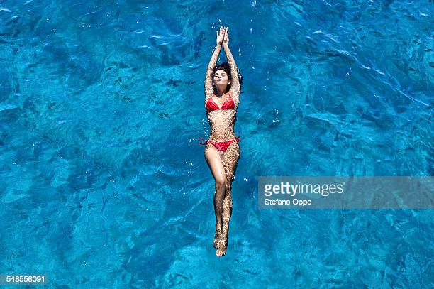 Young woman floating in sea