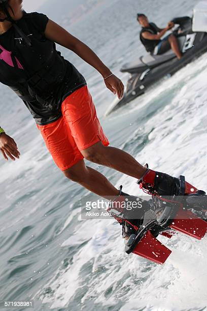 Young woman flyboarding