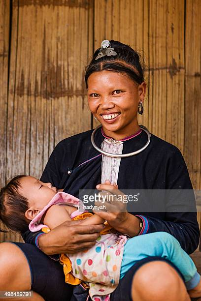 Young woman from the Lantan hill tribe breastfeeding her baby