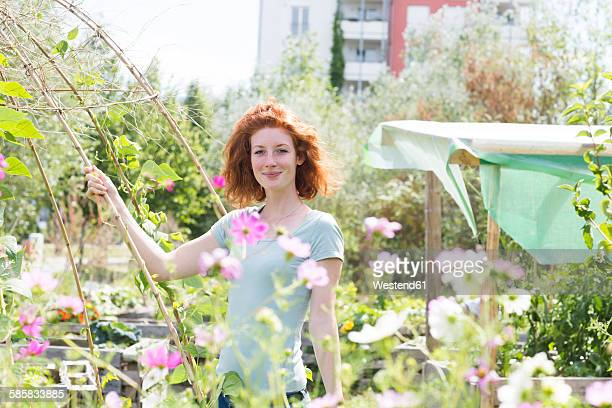 Young woman gardening, urban gardening