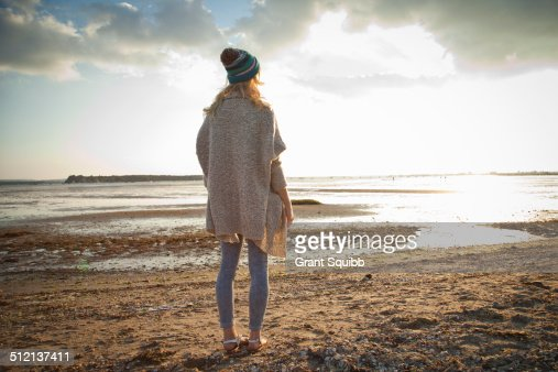 Young woman gazing on Bournemouth beach, Dorset, UK