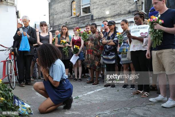 A young woman gestures as she lays flowers outside the Muslim Welfare House near the scene of the attack by Finsbury Park Mosque on June 19 2017 in...
