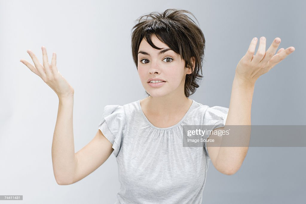 Young woman gesturing : Stock Photo