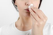 Young woman getting a bloody nose