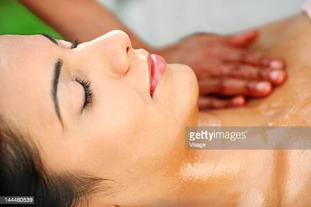Young woman getting a Pizhichil treatment done
