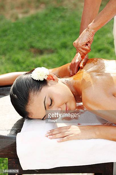 Young woman getting Abhyangam treatment