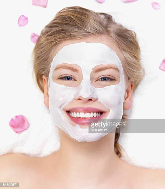 Young woman getting facial spa treatment