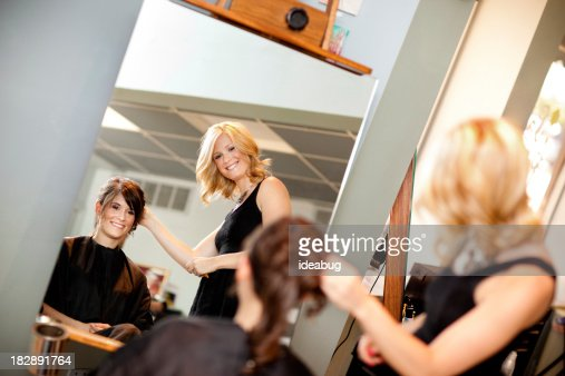 Young Woman Getting Hair Styled as Updo in Salon
