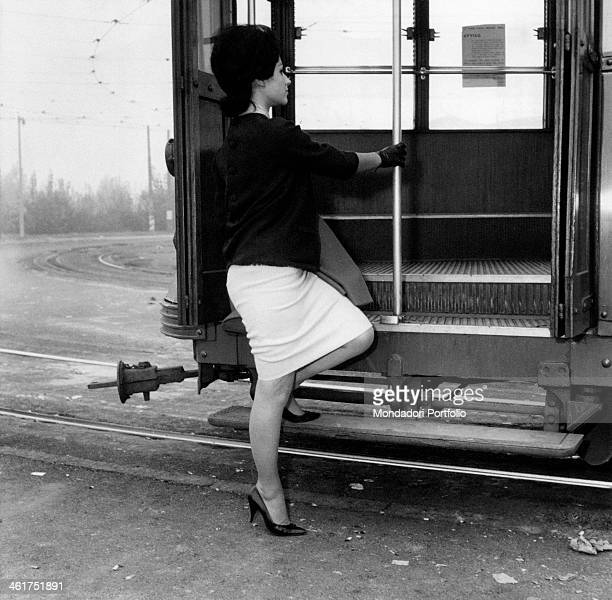 A young woman getting into the tram Milan 1960s