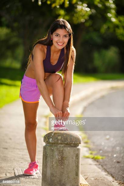 Young woman getting ready for pilates training and jogging