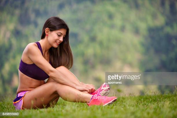 Young woman getting ready for pilates training.