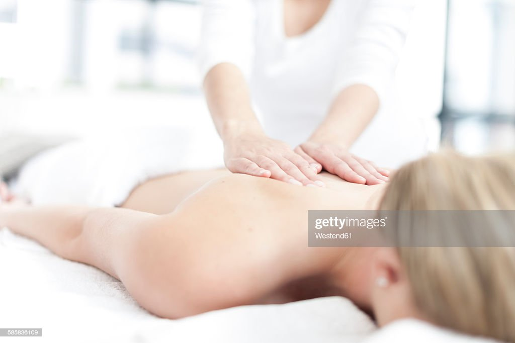 Young woman giving a massage