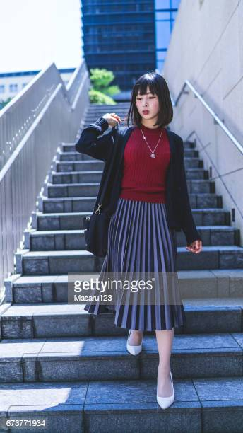 Young woman go down the stairs