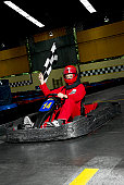 Young woman go-carting on a motor racing track