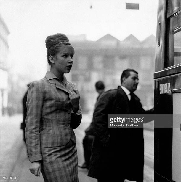 A young woman going to get into a tram Milan April 1961