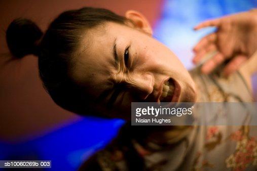 Young woman grimacing, portrait : Foto de stock
