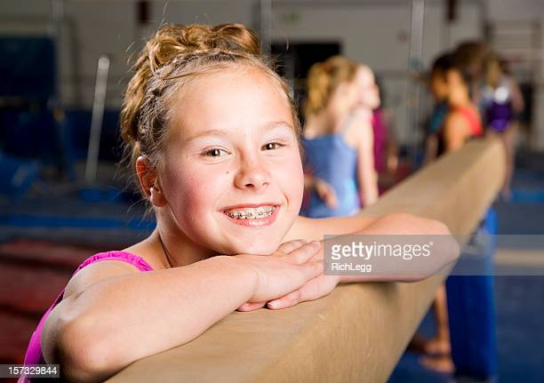 Young Woman Gymnast in a Gym