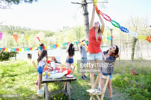 Young woman hanging up bunting