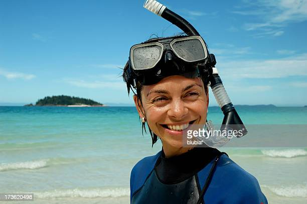 Young woman happily snorkeling