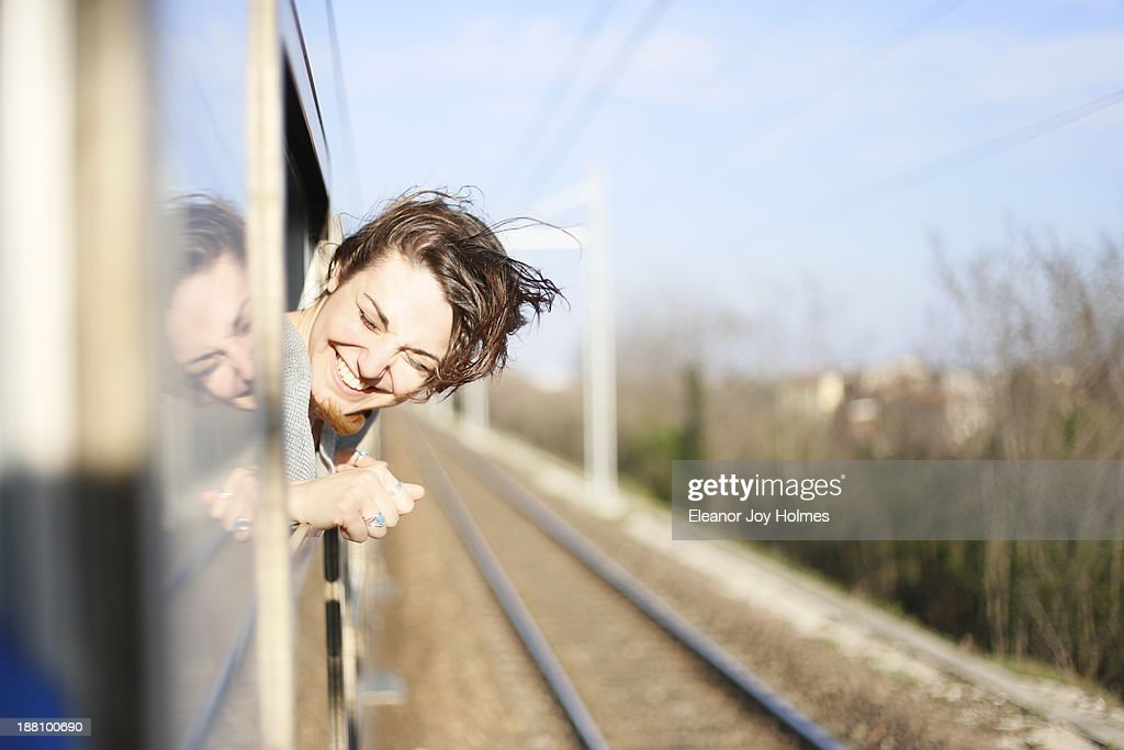 Young woman happy to be travelling : Stock Photo